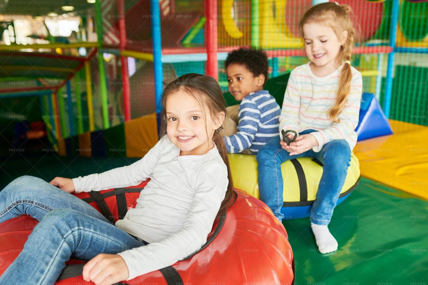 Children Enjoying Slides: Stock Photos