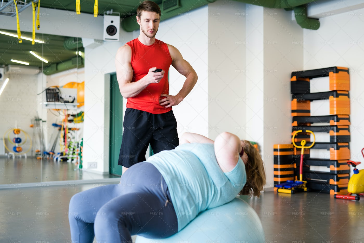 Obese Woman Training In Fitness...: Stock Photos