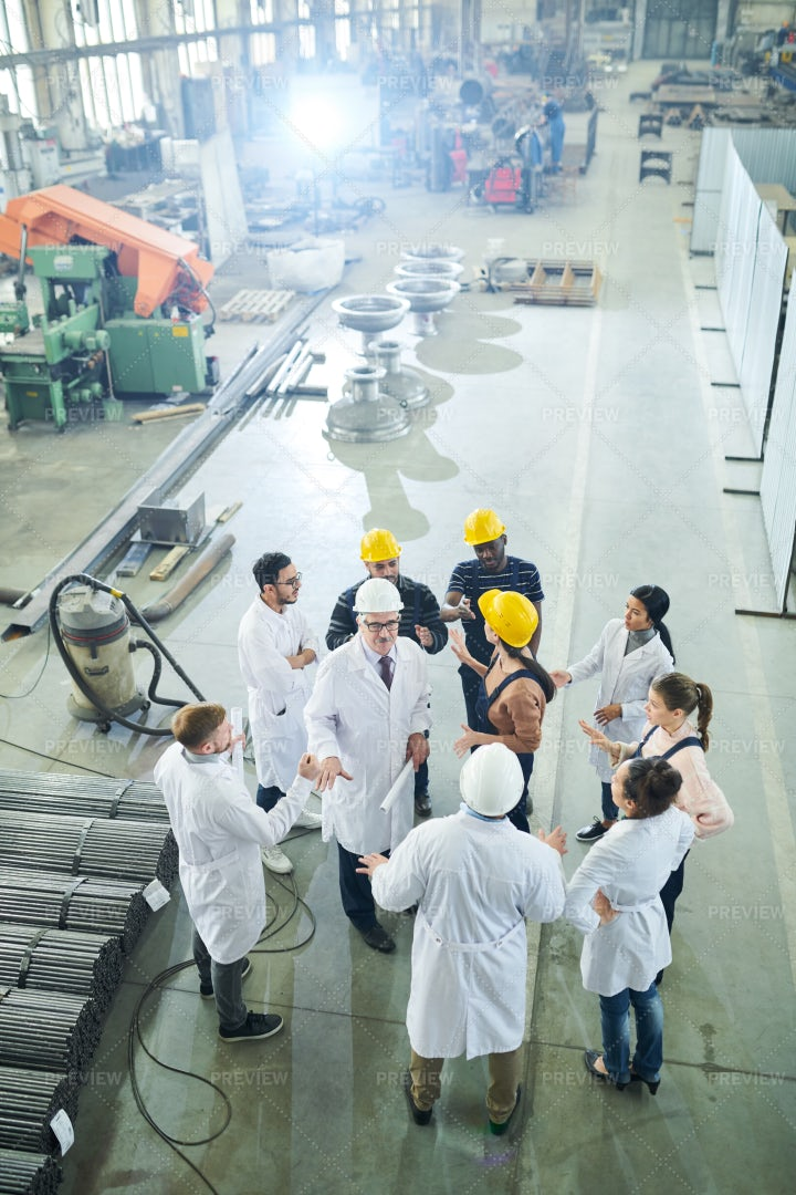 Meeting With Workers At Factory: Stock Photos