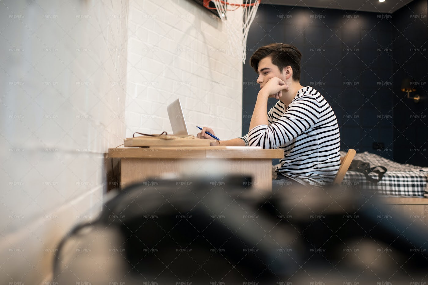Concentrated Young Man Sitting At...: Stock Photos