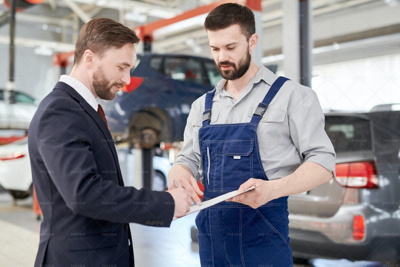 Businessman Signing Contract In Car...: Stock Photos