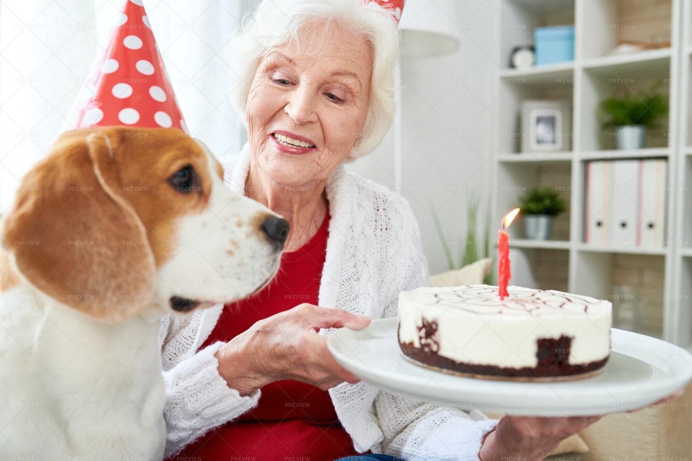 Senior Woman Holding Birthday Cake: Stock Photos