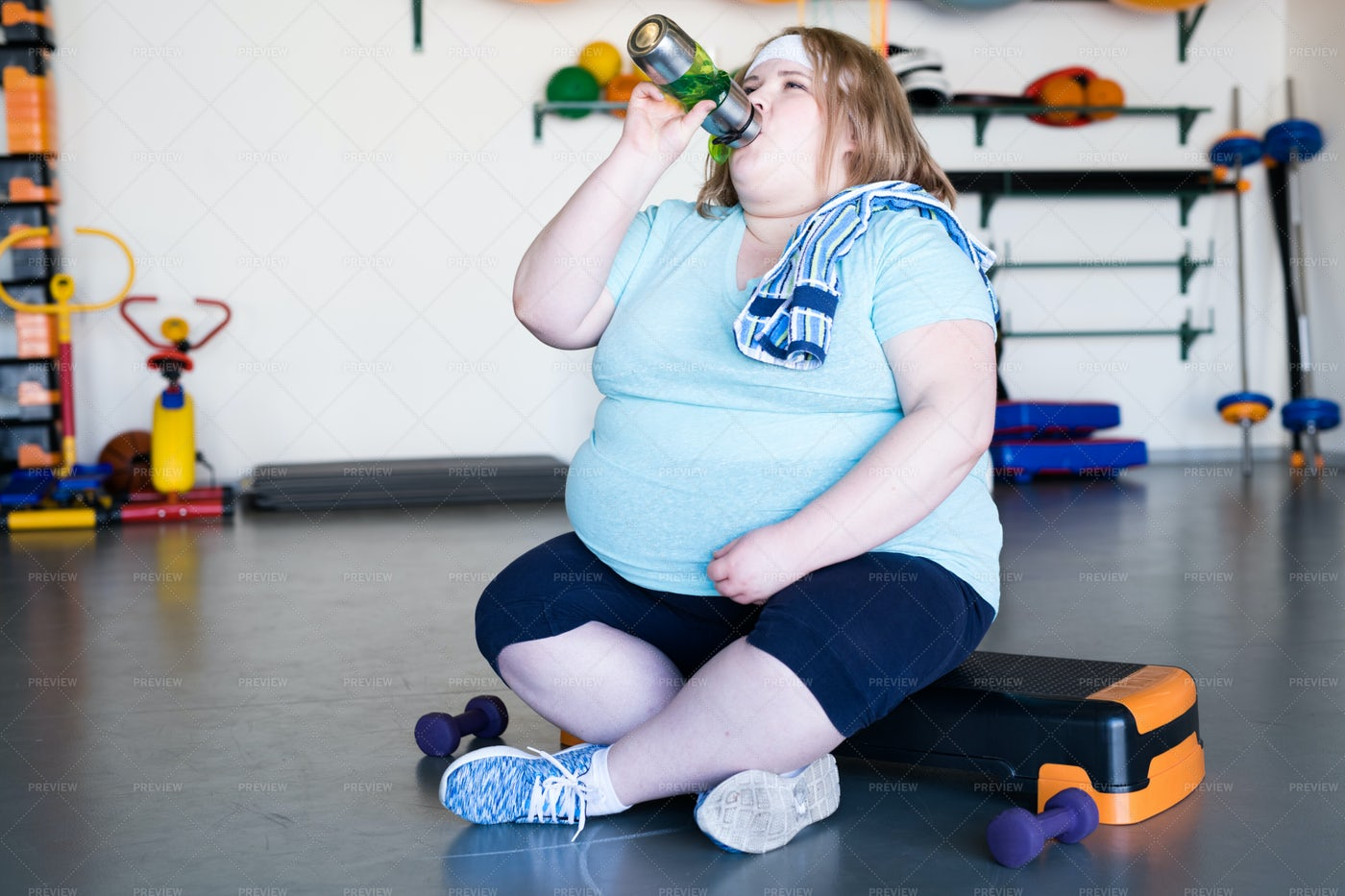 Exhausted Overweight Woman In Gym: Stock Photos