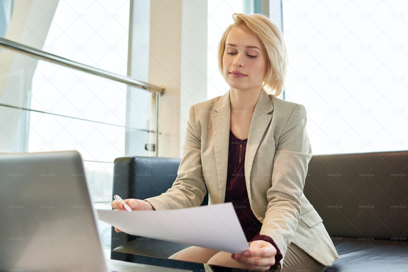 Blond-haired Entrepreneur Focused...: Stock Photos