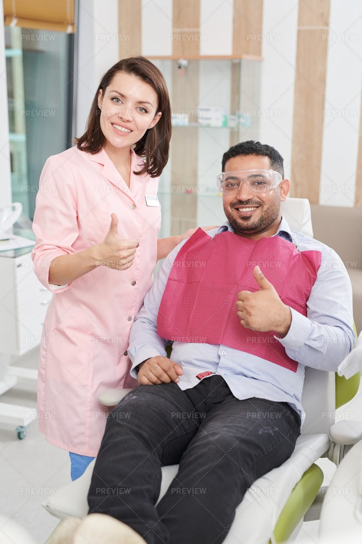 Female Dentist Posing With Patient: Stock Photos