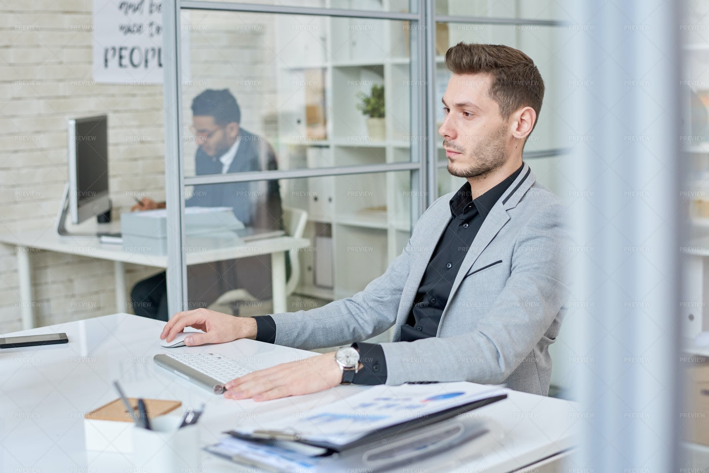 Young Businessman Working In...: Stock Photos