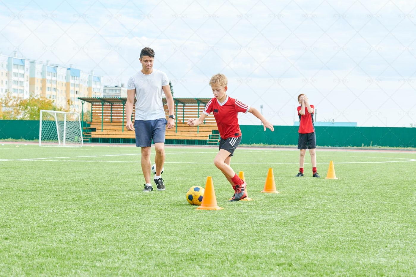 Coach Training Football Team: Stock Photos