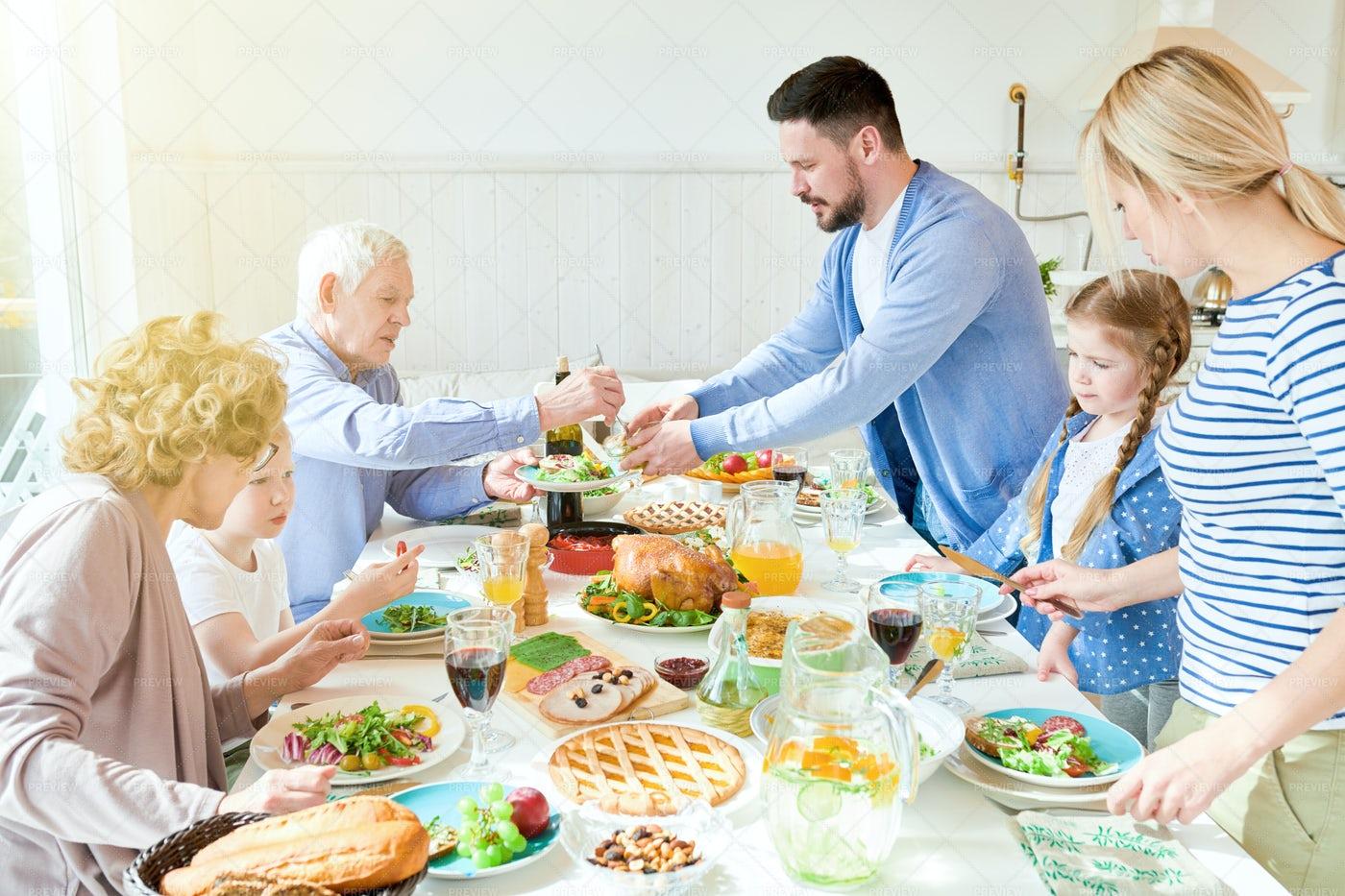 Family Enjoying Festive Dinner In...: Stock Photos