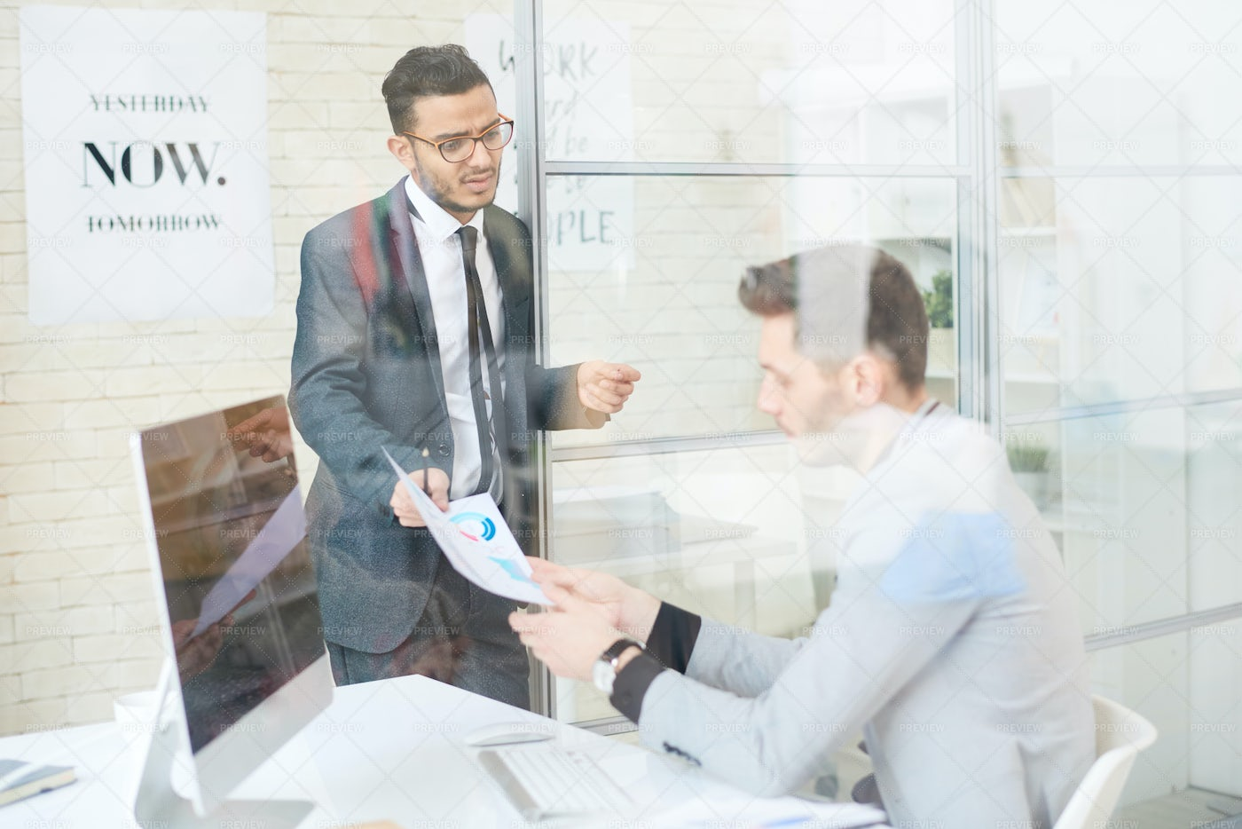 Manager Talking To Employee In...: Stock Photos