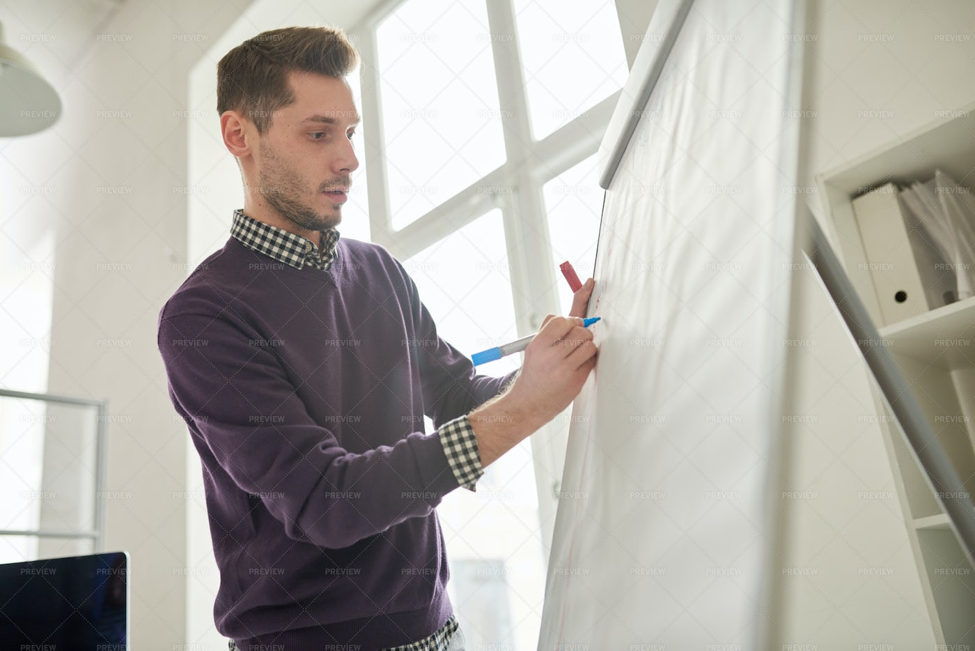 Young Man Writing On Whiteboard: Stock Photos