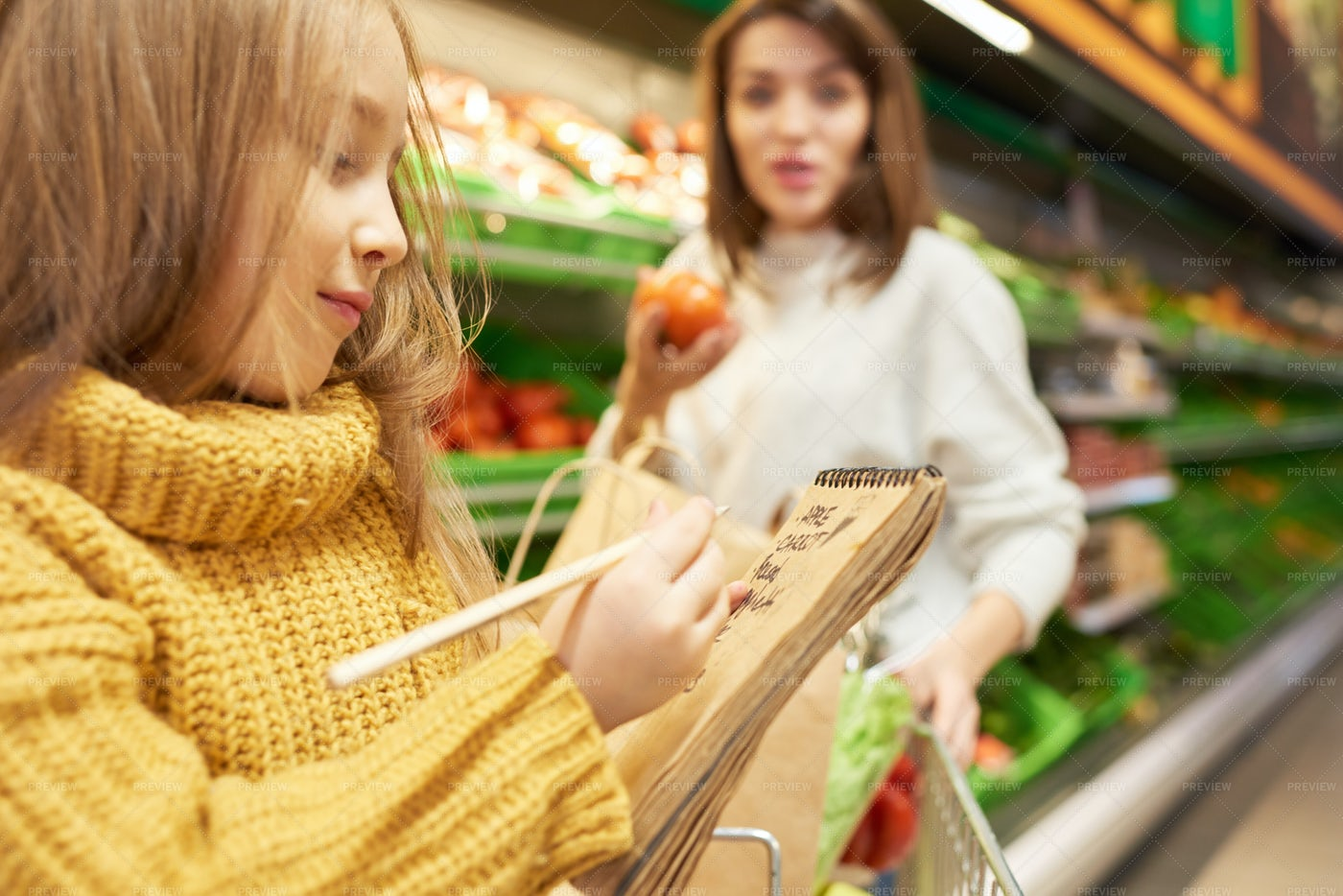 Little Girl Holding Shopping List: Stock Photos