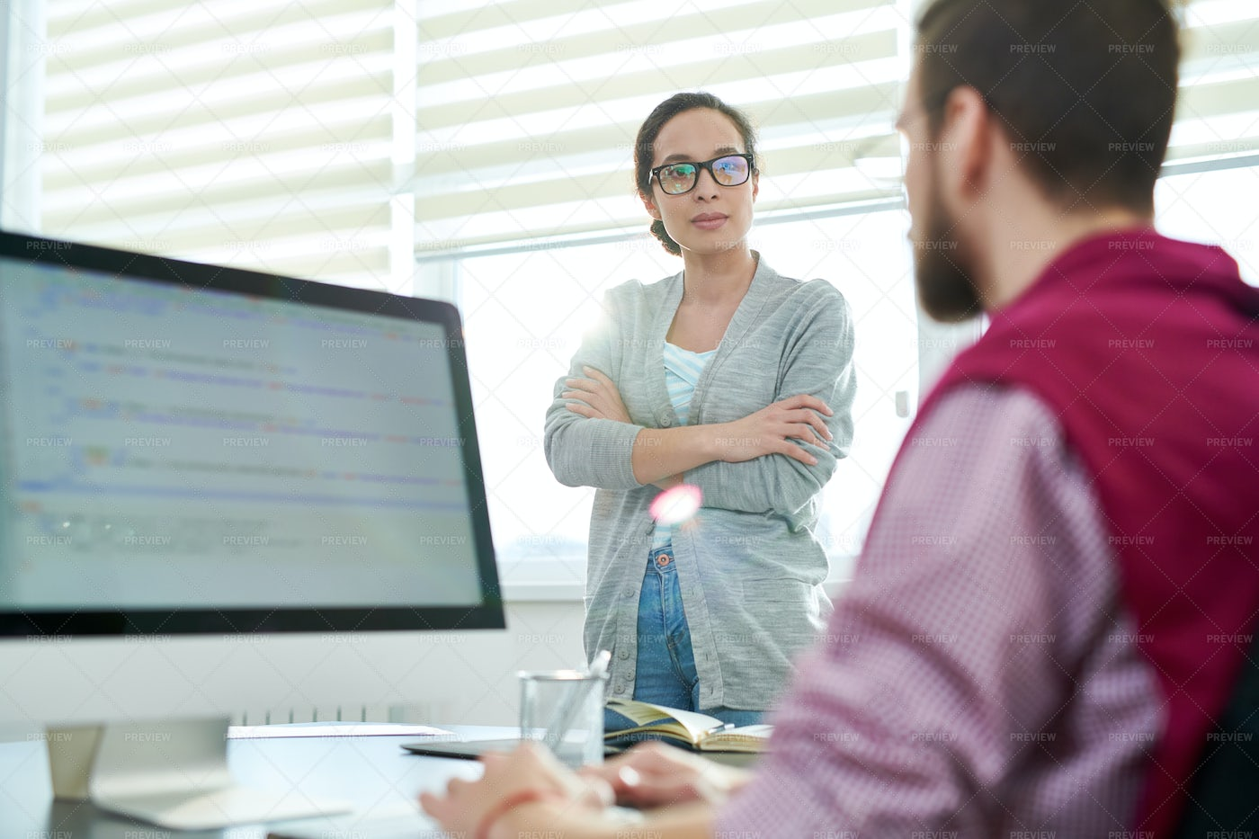 Colleagues Communicating At Work: Stock Photos