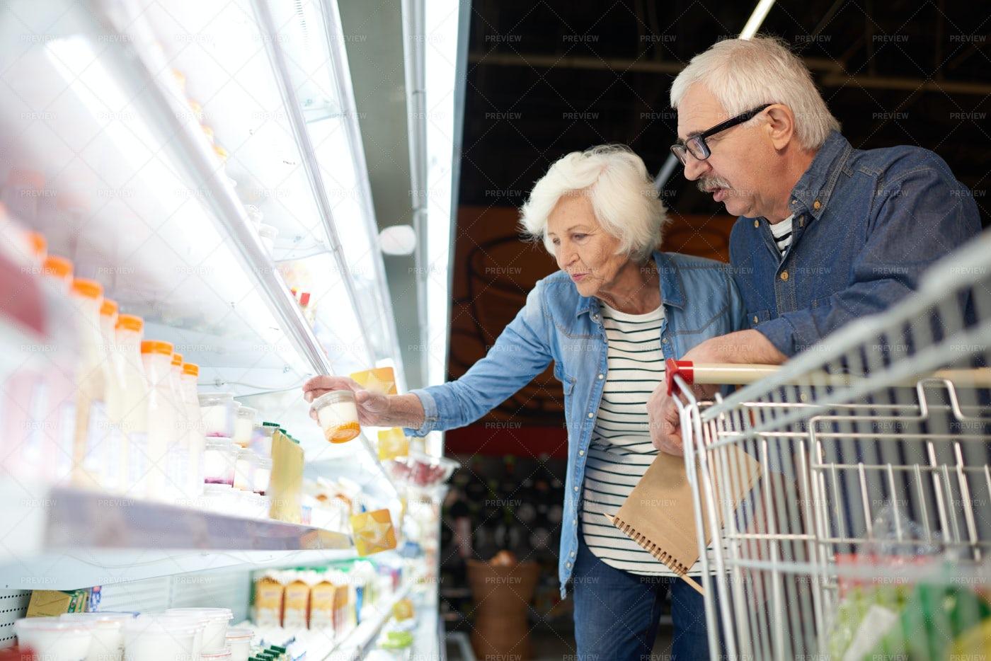 Modern Senior Couple Buying Food: Stock Photos