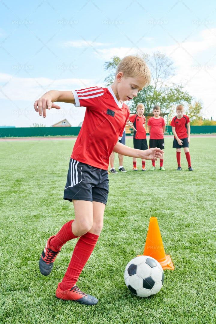 Boy Doing Football Exercises: Stock Photos