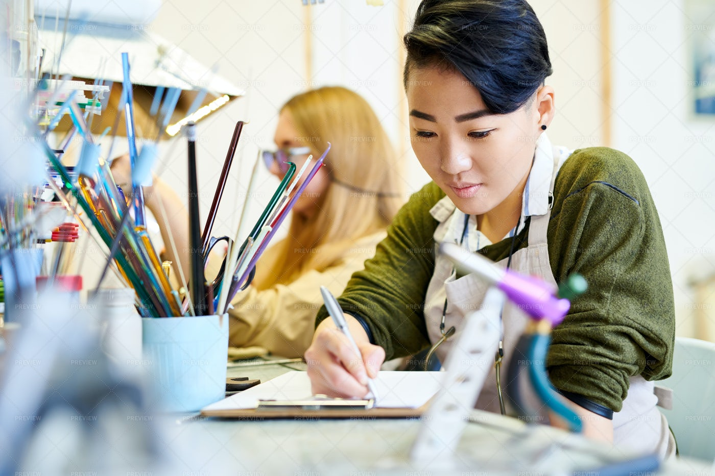 Creative Woman Drawing In Workshop: Stock Photos