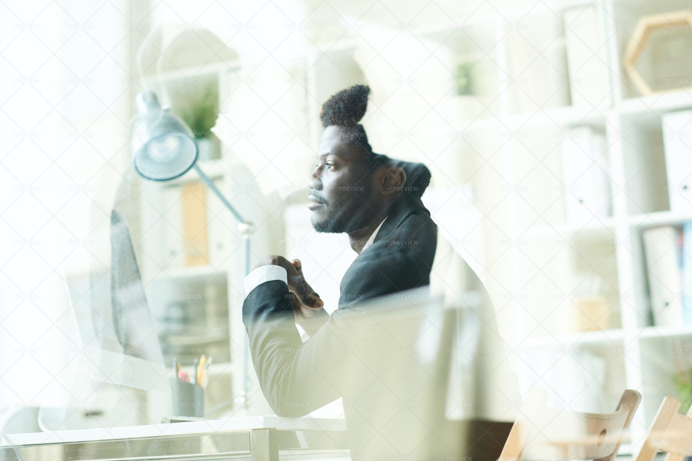 Young  African Businessman Using PC: Stock Photos