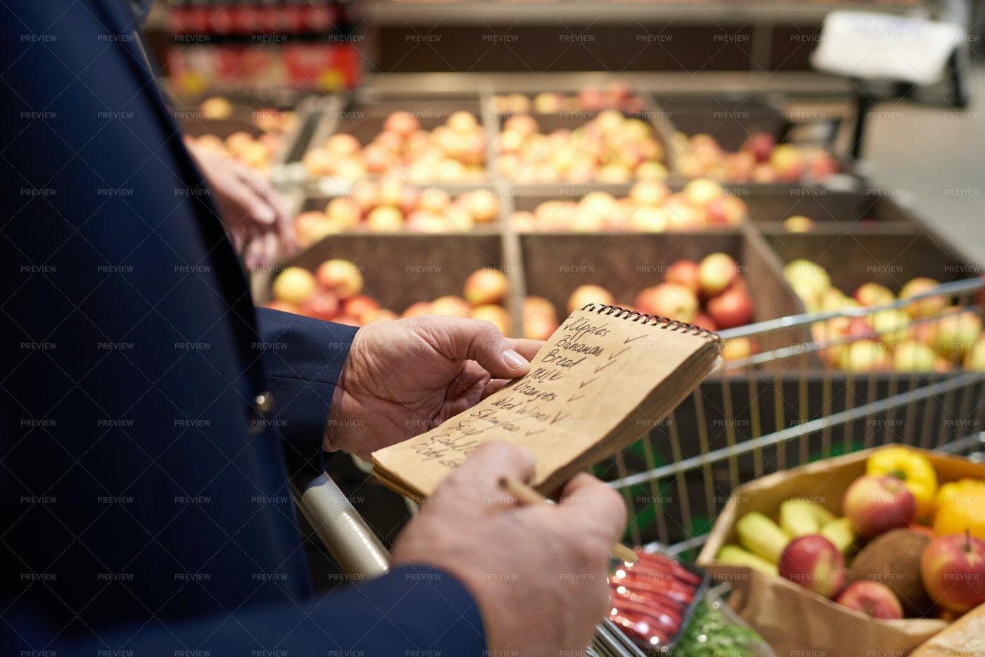 Senior Man Holding Shopping List: Stock Photos