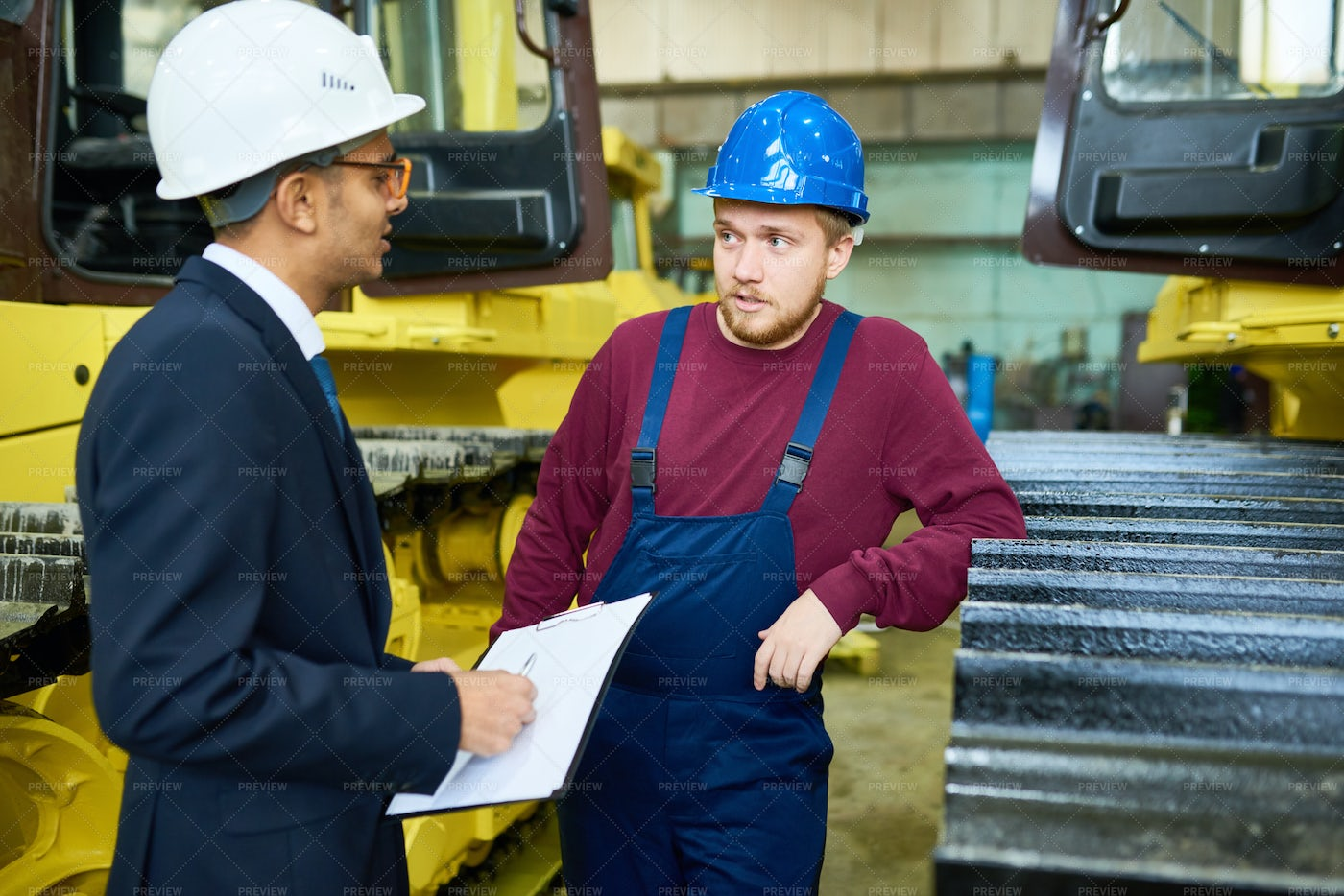 Showing Heavy Equipment To Customer: Stock Photos