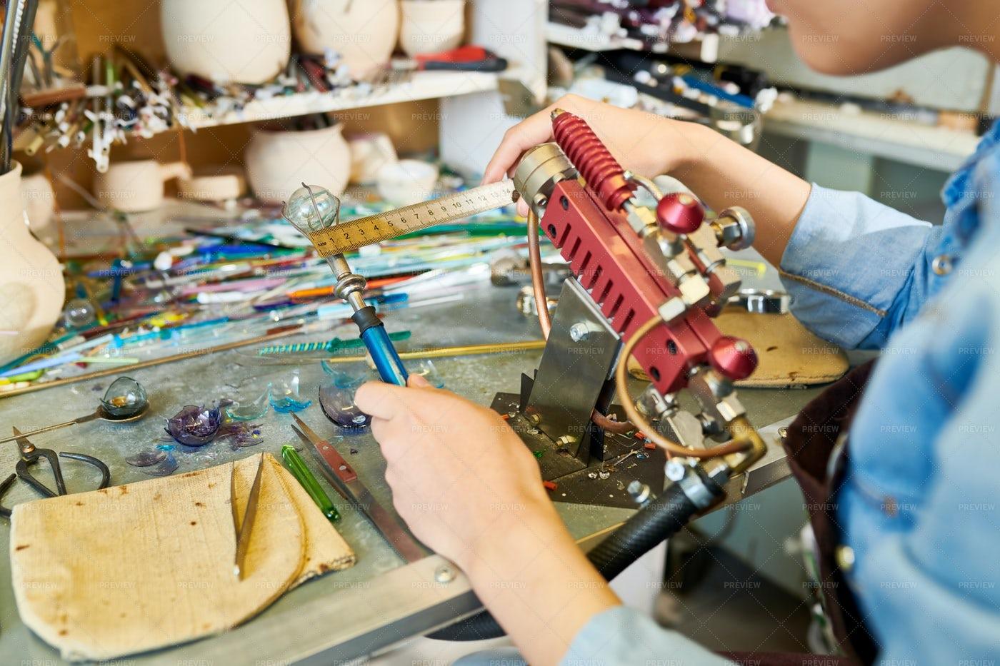 Artist Doing Lampwork In Studio: Stock Photos