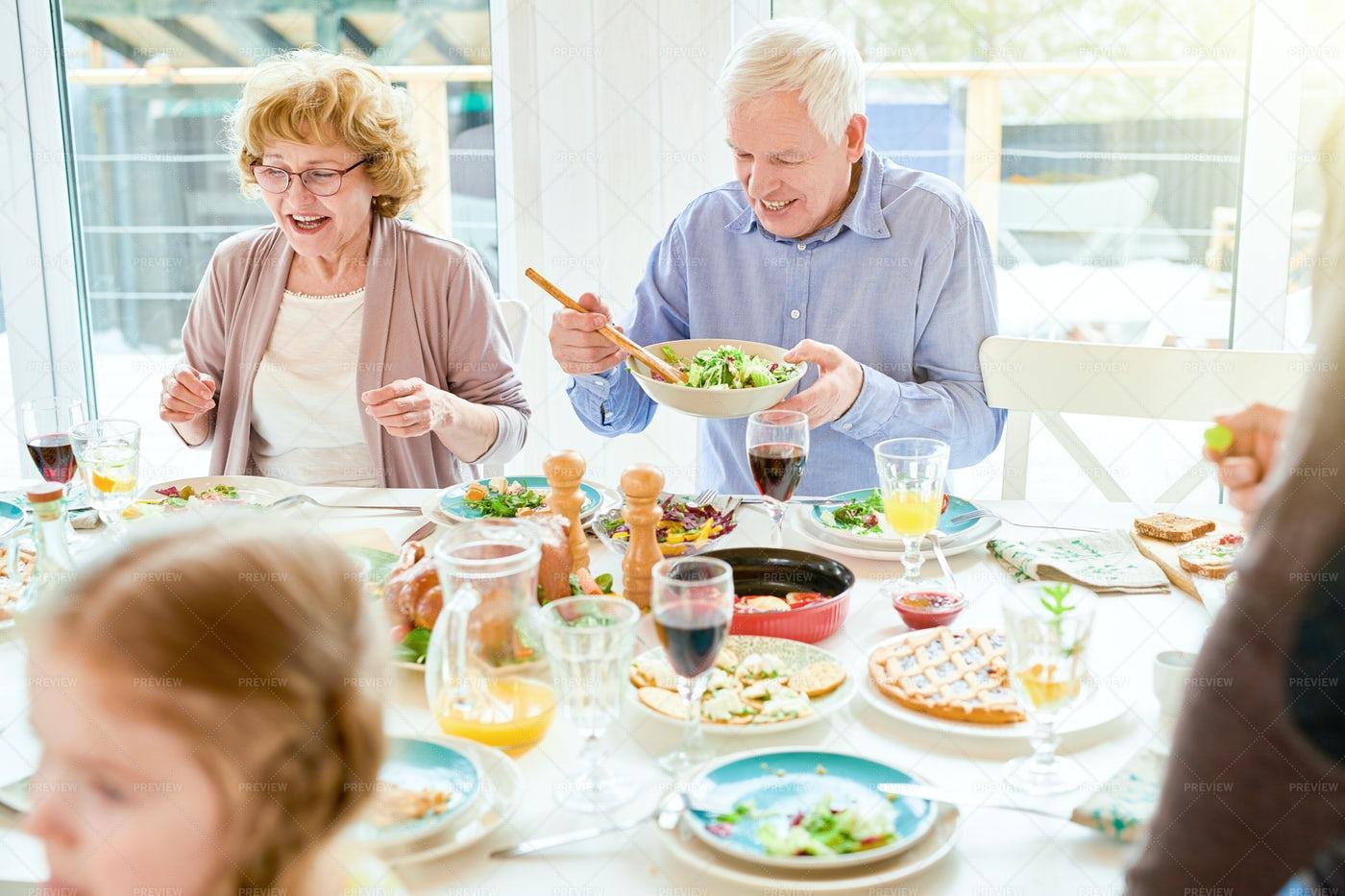 Grandparents Enjoying Food At...: Stock Photos