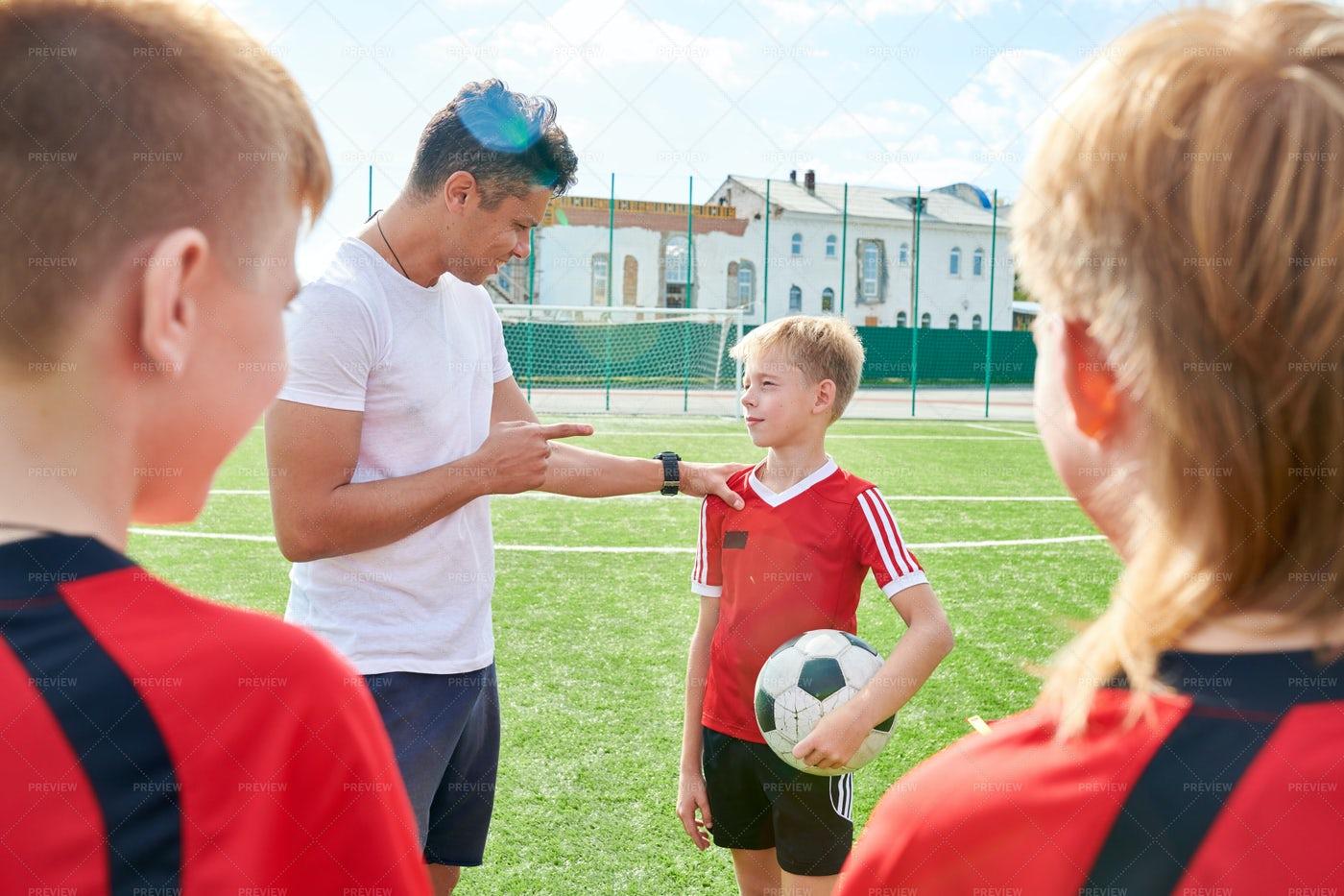 Coach Motivating Young Players: Stock Photos