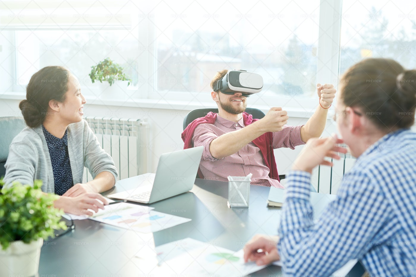 Office Workers Trying New Gadget: Stock Photos