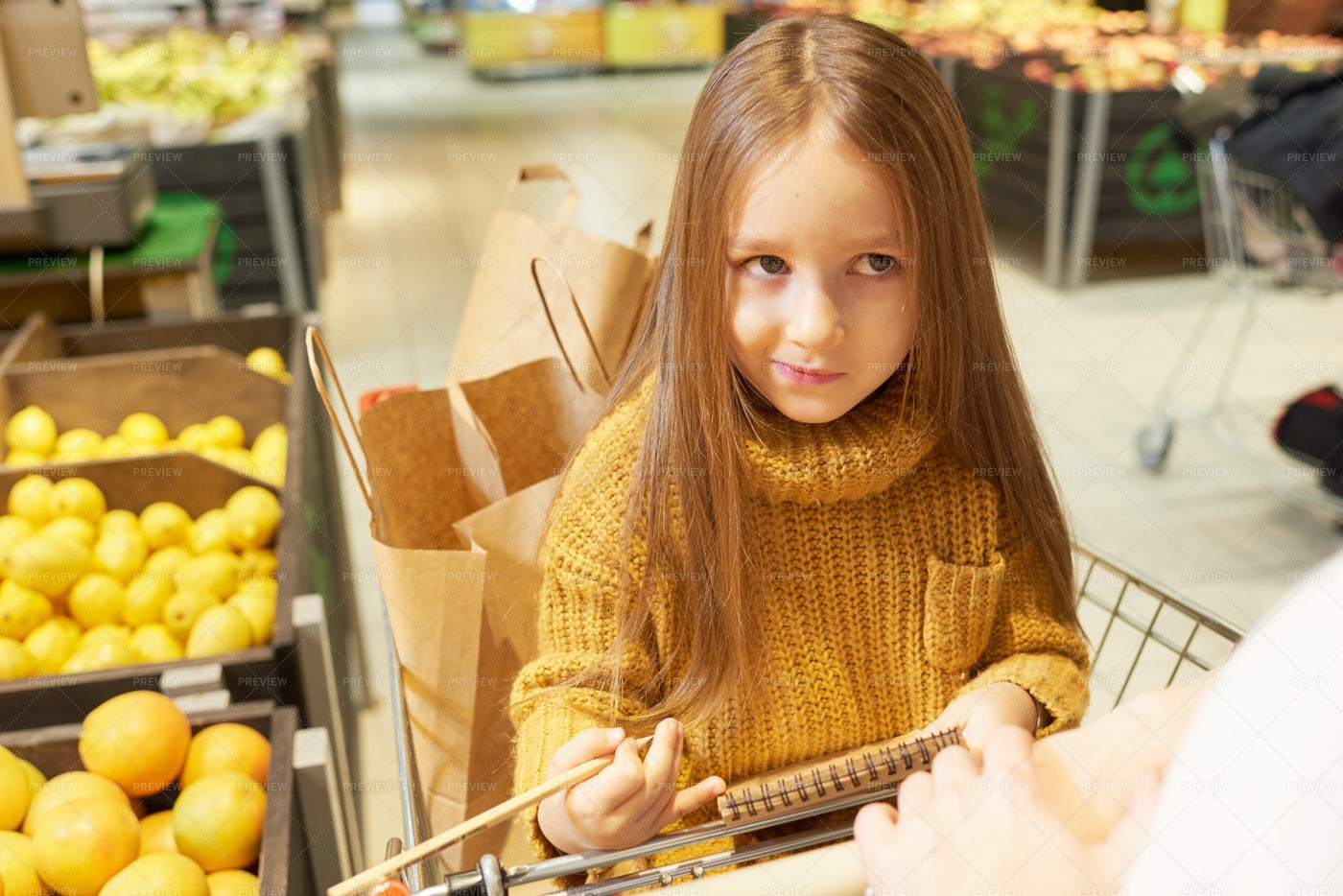 Little Girl Sitting In Shopping...: Stock Photos