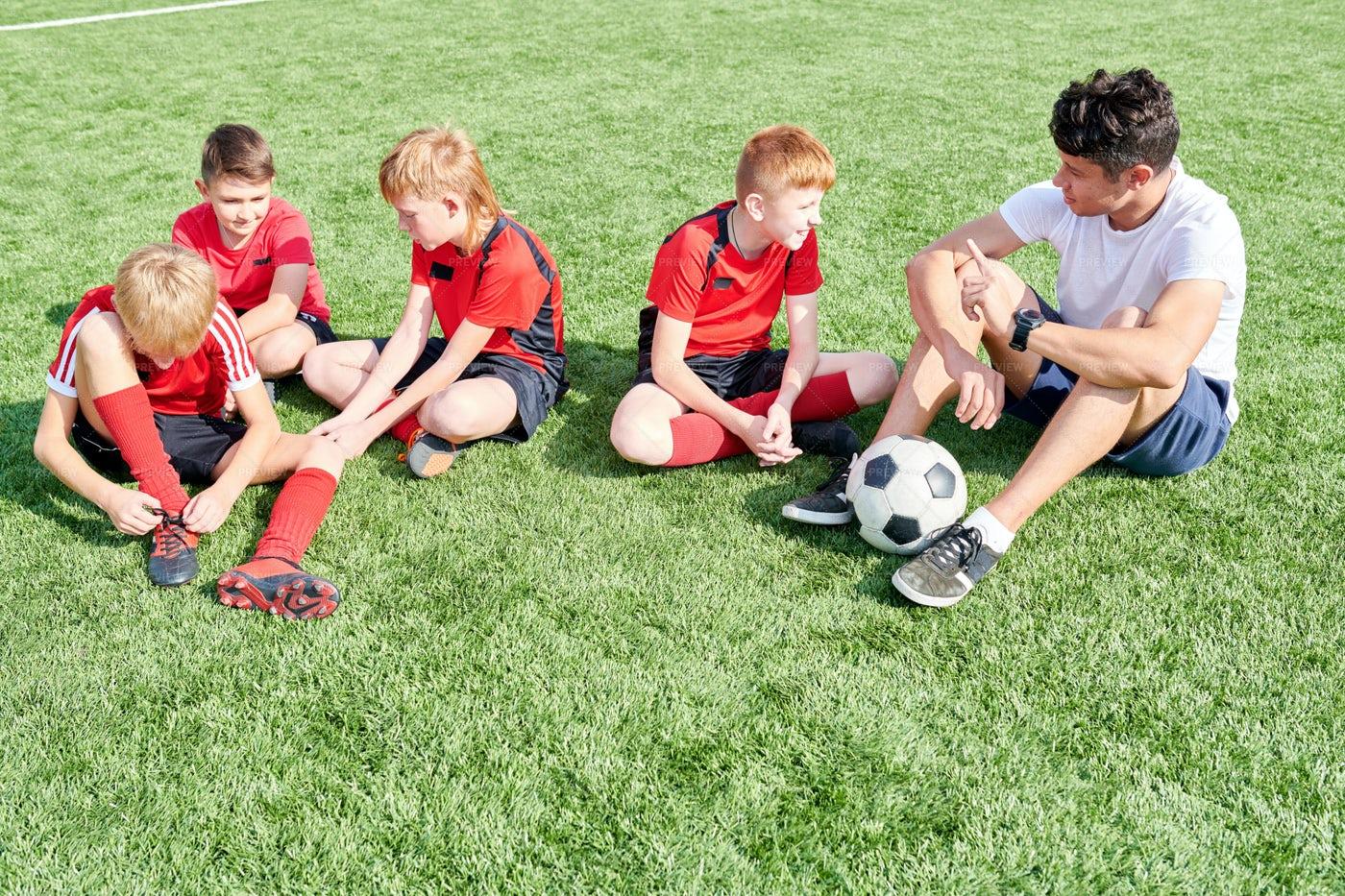 Junior Football Team Resting In...: Stock Photos