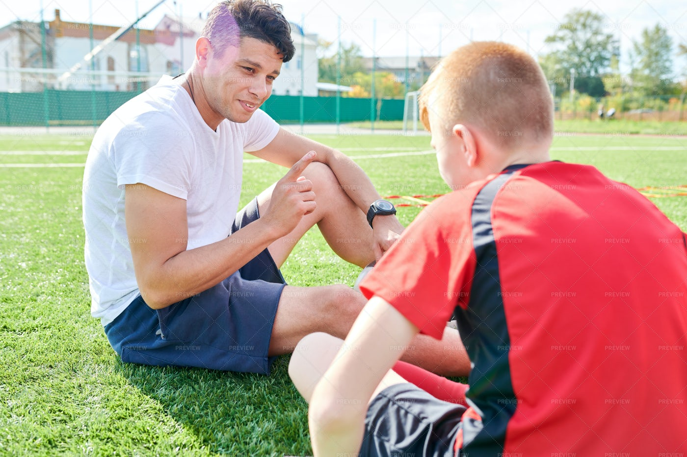 Sports Coach Talking To Boy: Stock Photos