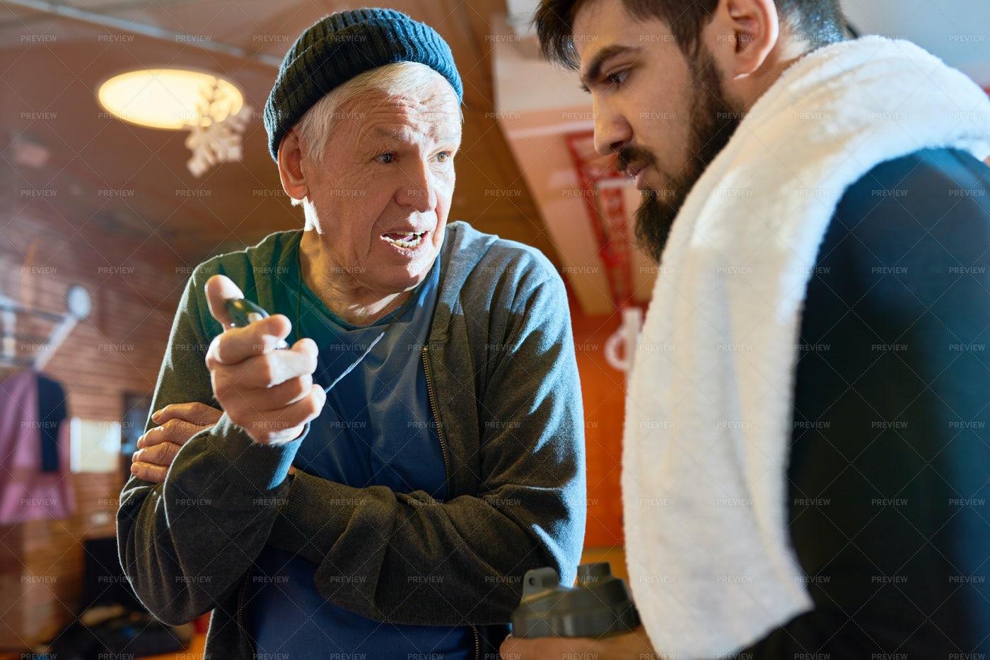Senior Coach Talking To Sportsman: Stock Photos