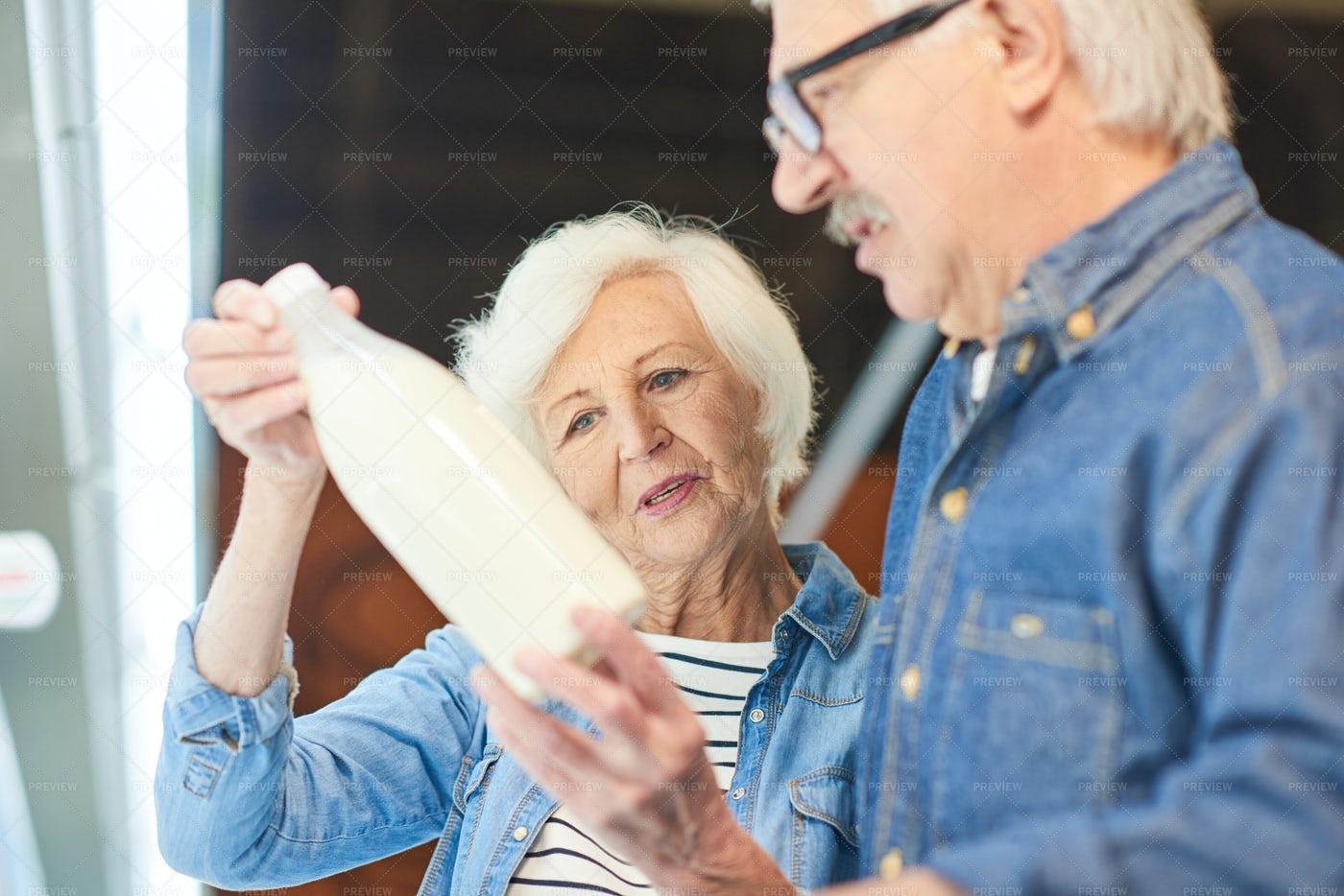 Senior Couple Choosing Milk: Stock Photos