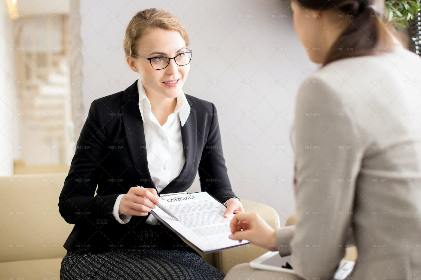Female Customer Signing Contract: Stock Photos