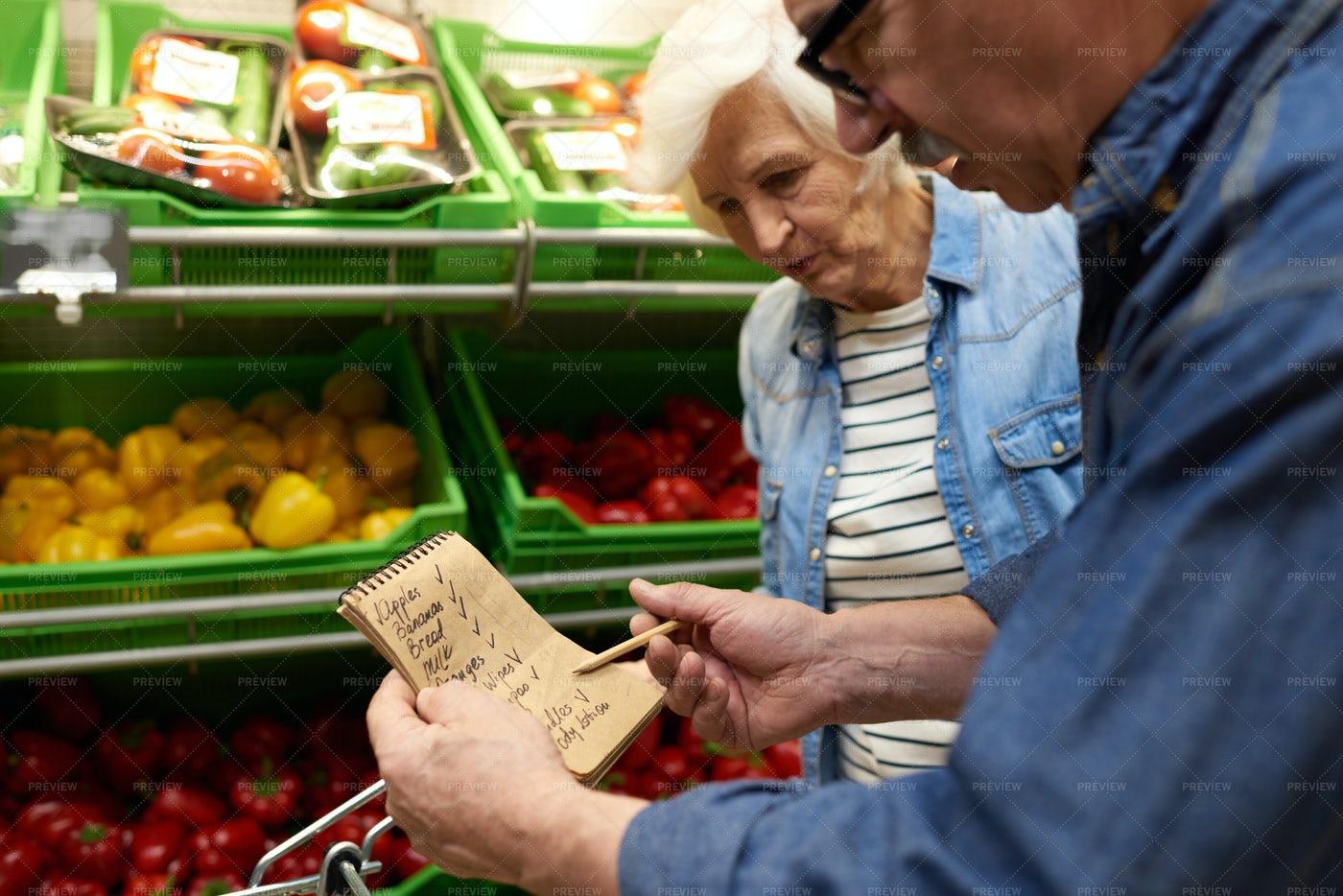 Senior Couple In Supermarket: Stock Photos