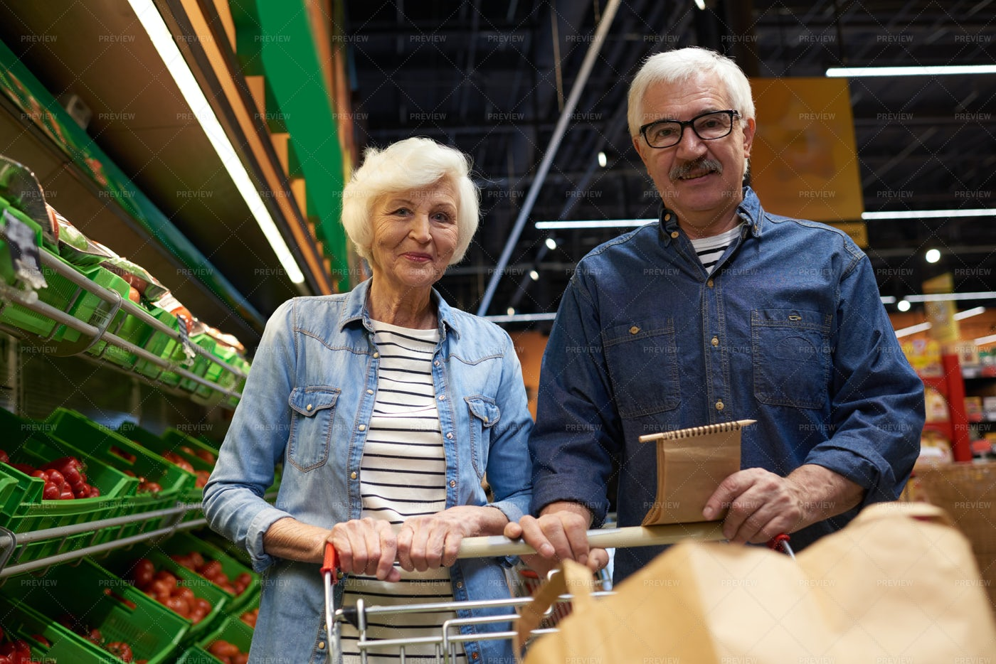 Senior Couple Posing In Supermarket: Stock Photos