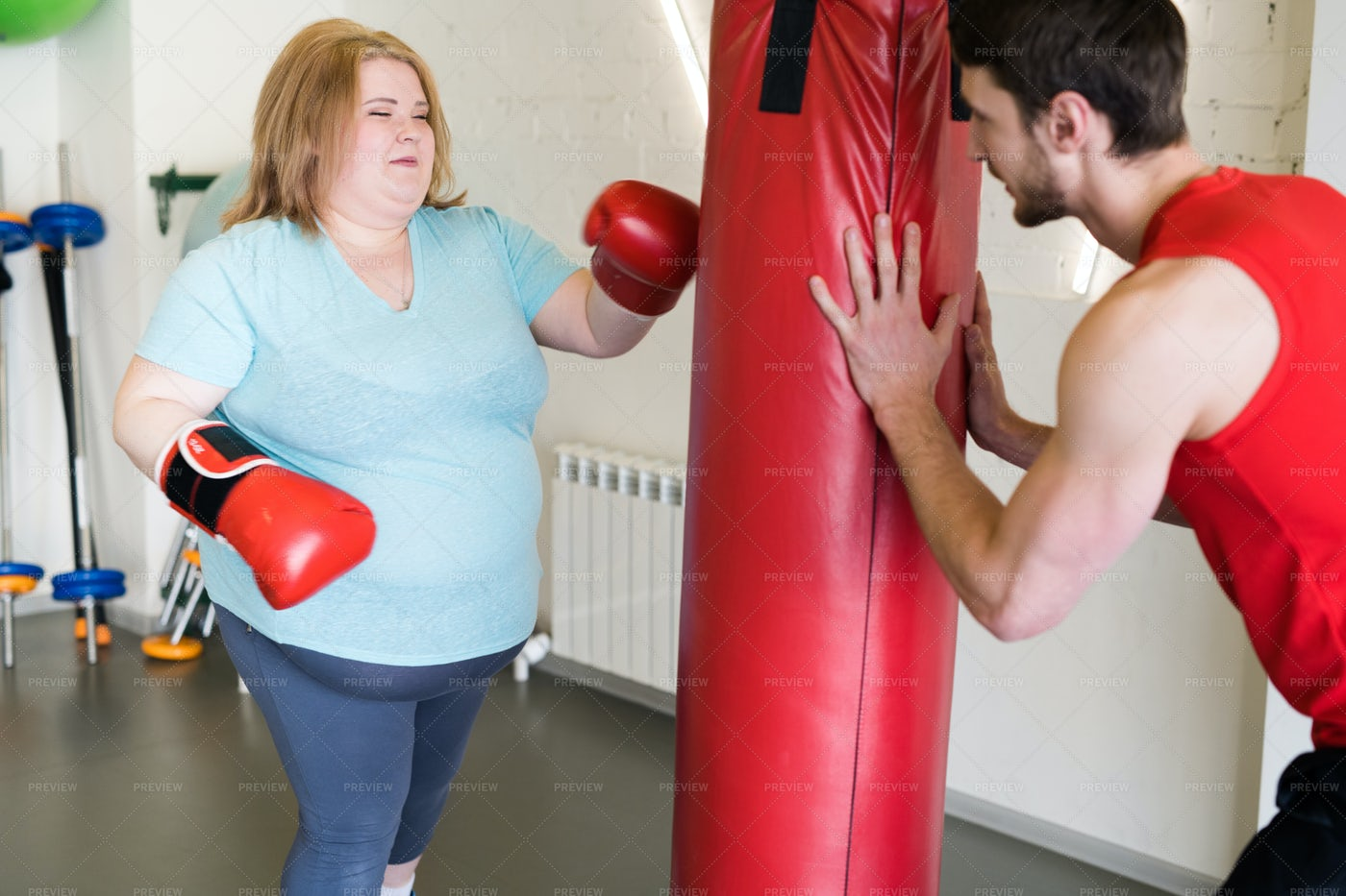 Obese Woman Boxing In Gym: Stock Photos