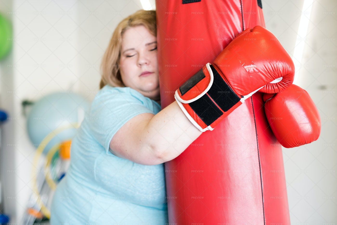 Tired Obese Woman Training In Gym: Stock Photos