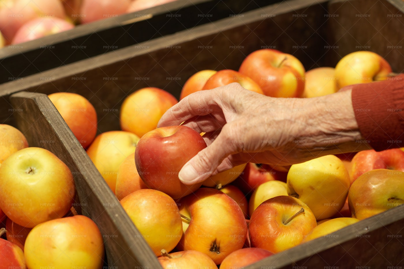 Hand Taking Apples In Supermarket: Stock Photos