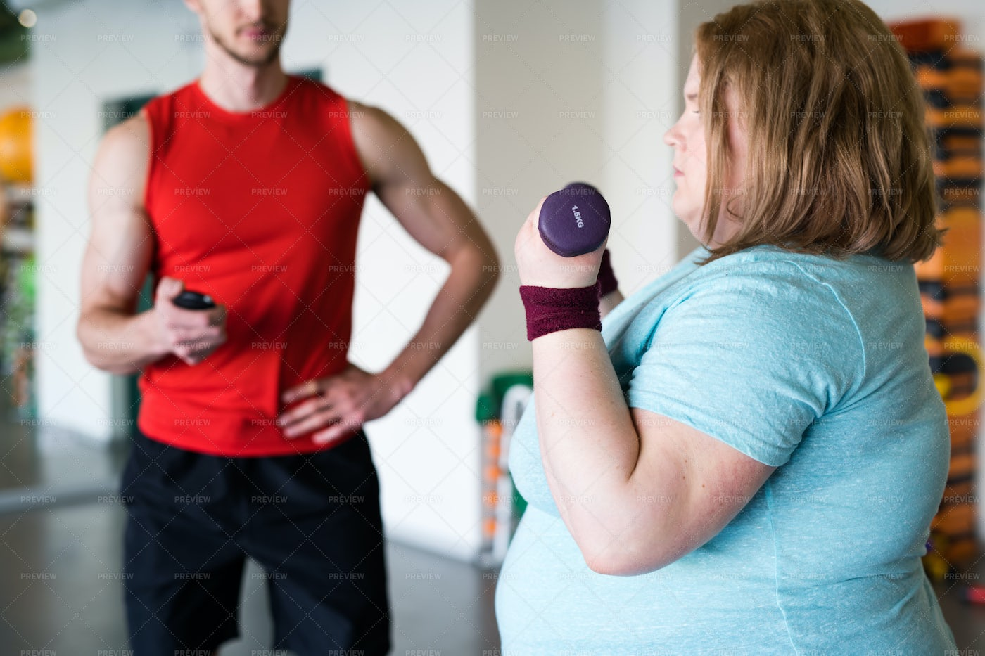 Obese Woman Working Out  With...: Stock Photos