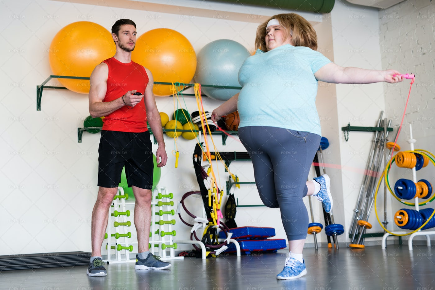 Obese Woman Jumping Rope: Stock Photos
