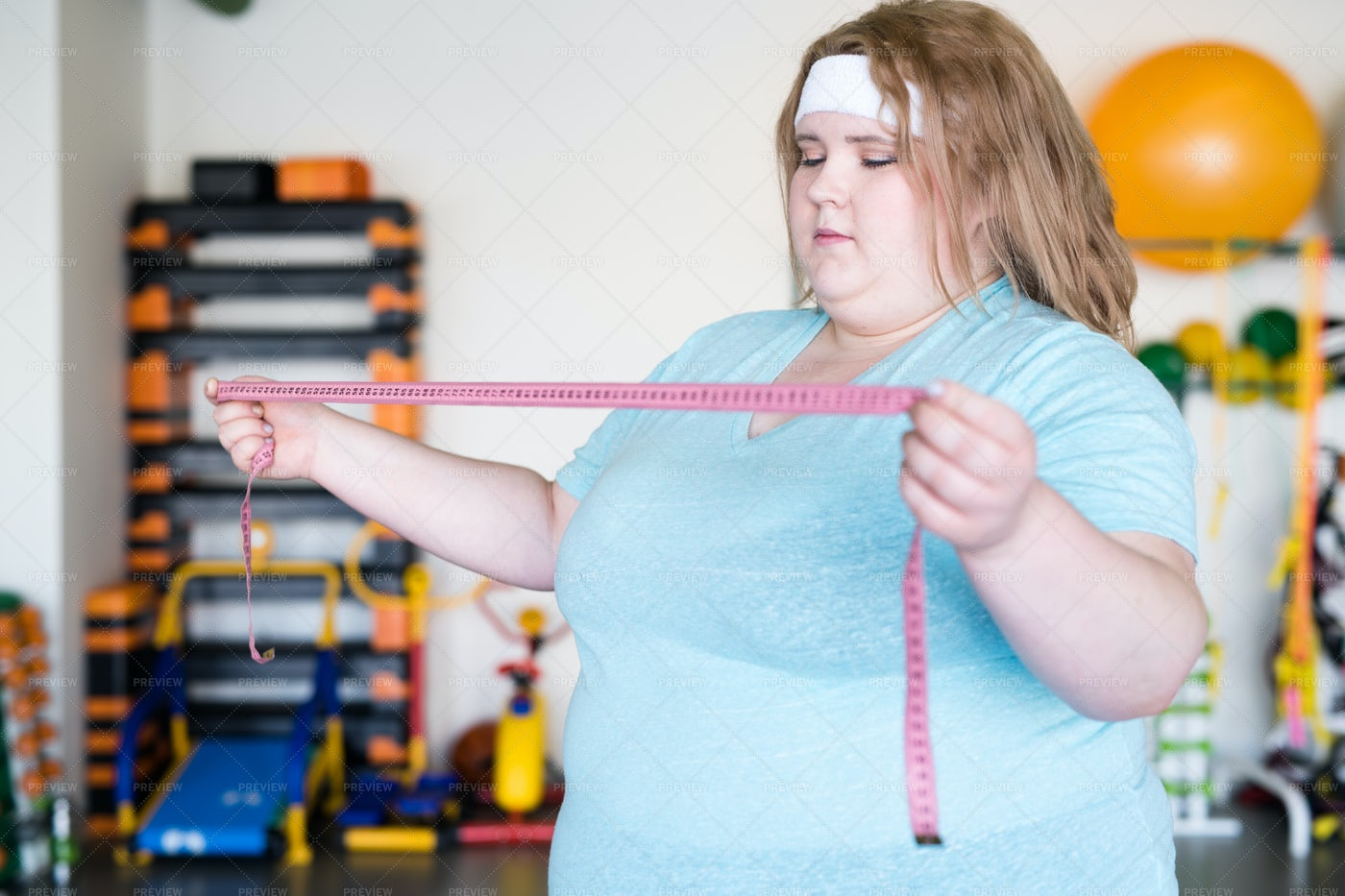 Obese Woman Holding Tape Measure: Stock Photos