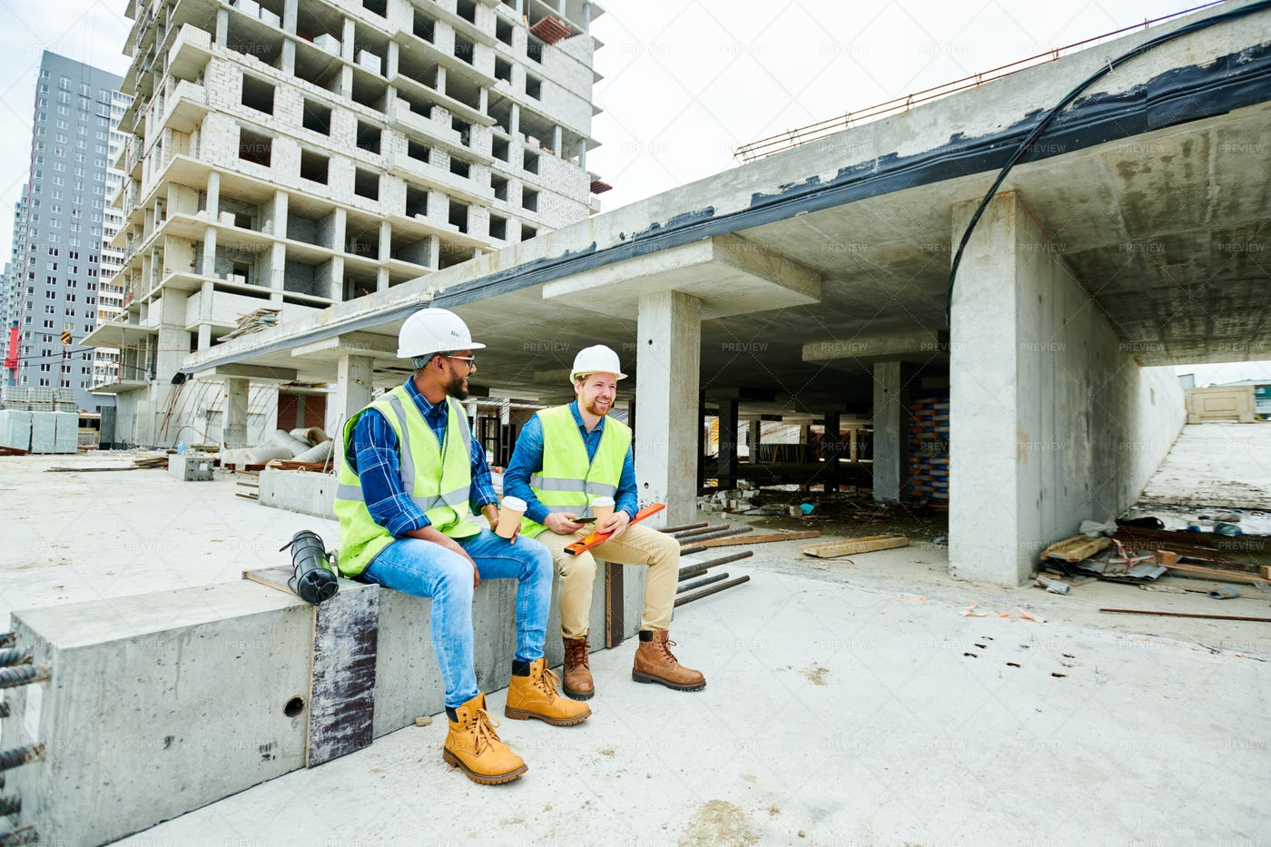 Positive Builders Relaxing On...: Stock Photos