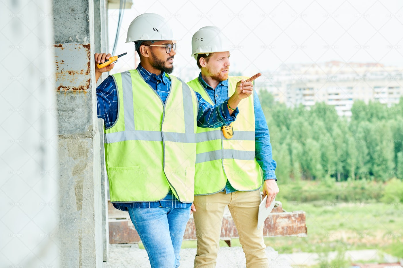 Workers Discussing Location Of...: Stock Photos