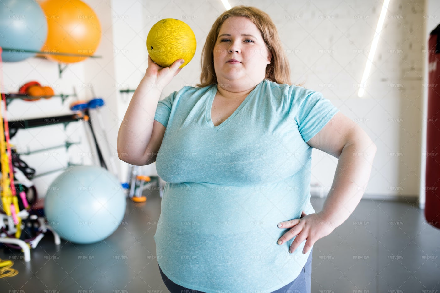 Overweight Woman Training With Ball: Stock Photos
