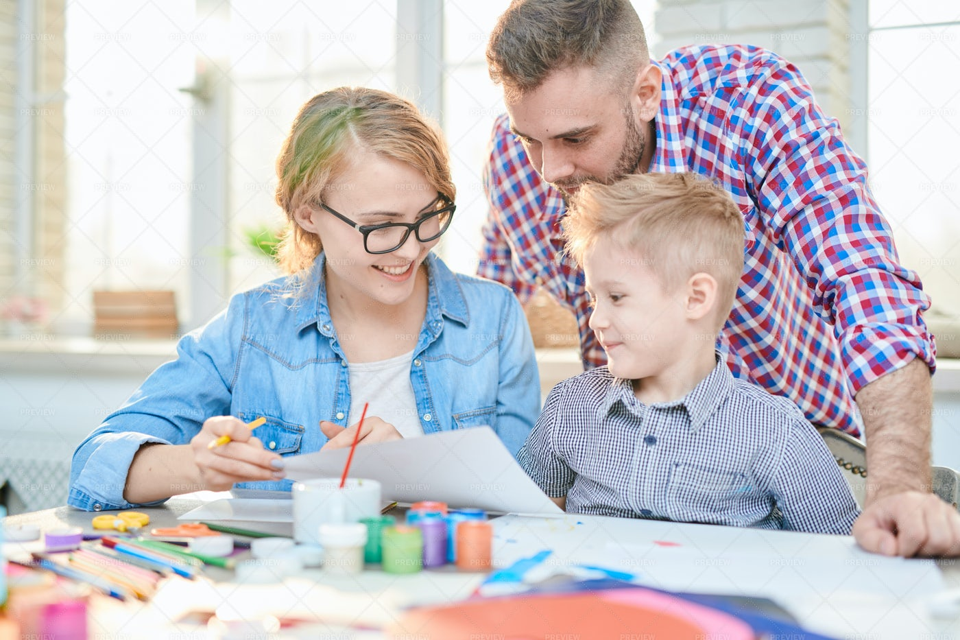 Family Crafting Together At Home: Stock Photos