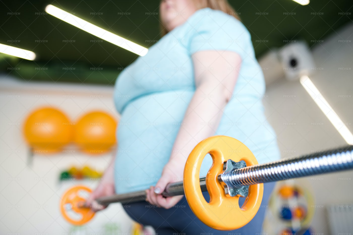 Overweight Woman Working Out With...: Stock Photos