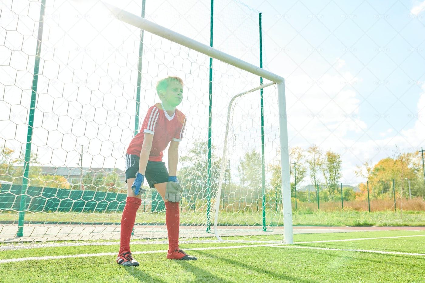 Boy Defending Gate In Sunlight: Stock Photos