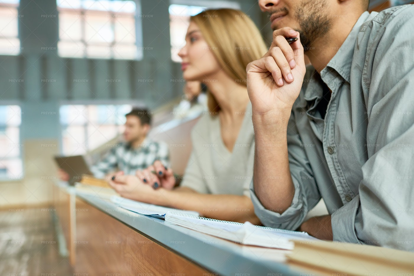 Students Listening To Lecture At...: Stock Photos