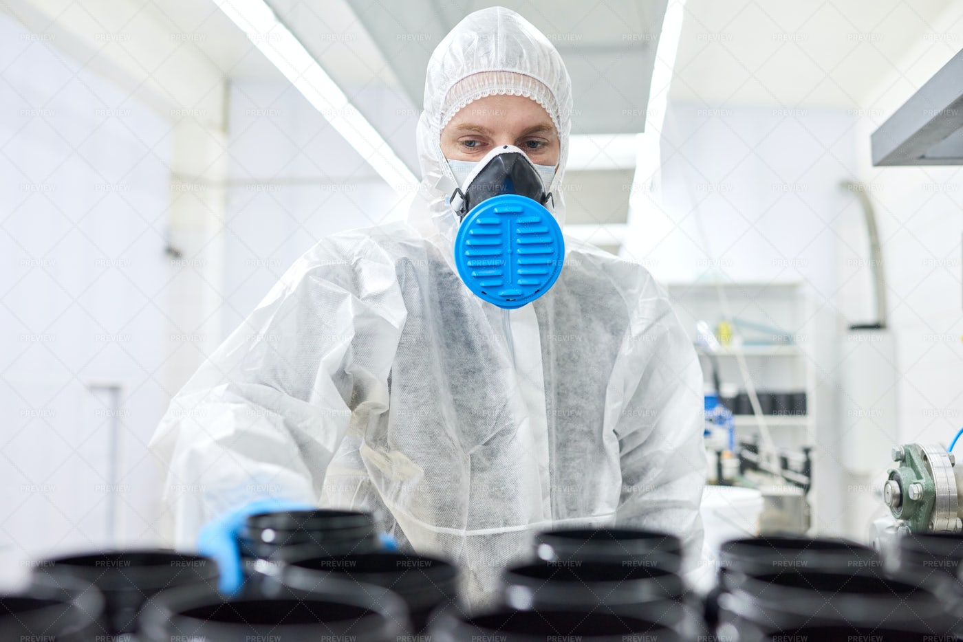 Factory Worker In Respirator Taking...: Stock Photos