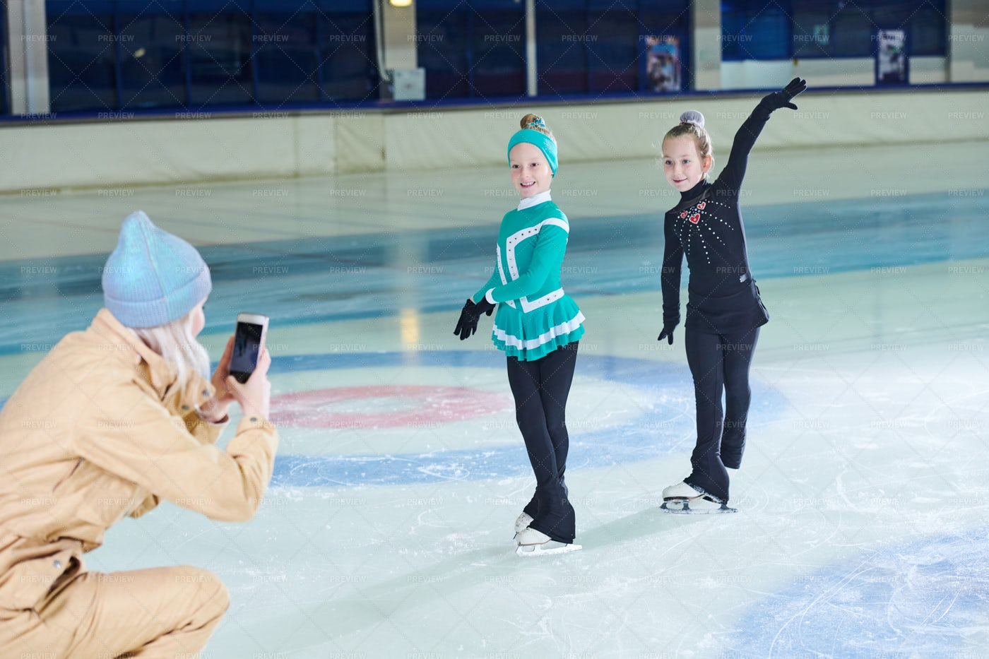 Woman Taking Photo Of Ice-Skaters: Stock Photos