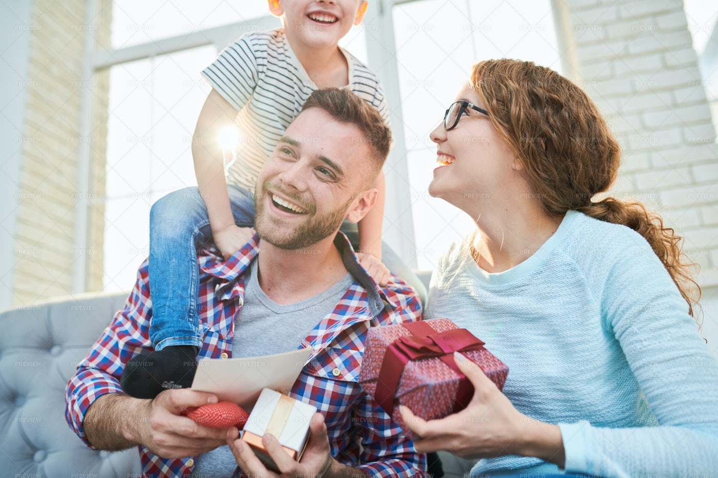 Playful Young Family In Sunlight: Stock Photos